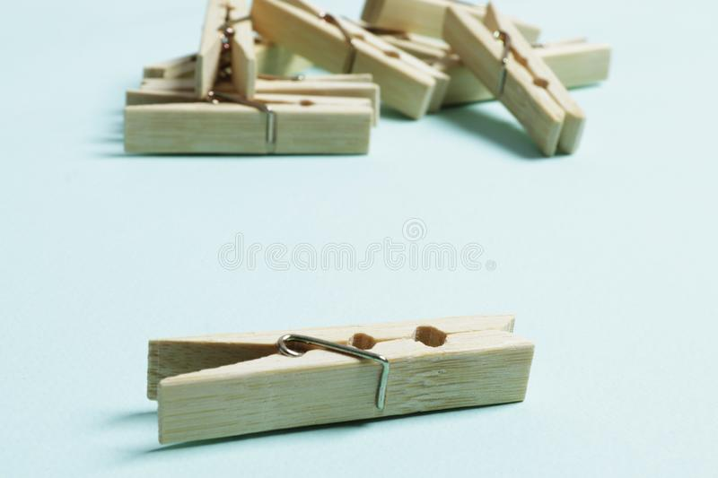 Wooden clothespins on a blue background royalty free stock photos