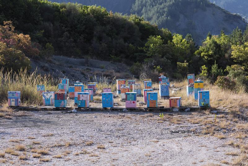 A lot of wooden colorful hives along country road on the mountain background in the Greece stock images