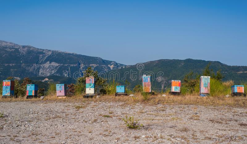 A lot of wooden colorful hives along country road on the mountain background in the Greece royalty free stock photography