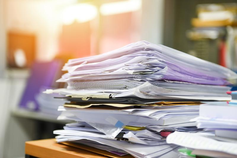 Lot of work document file working stacks of paper files searching information on work desk office - business report papers piles stock image