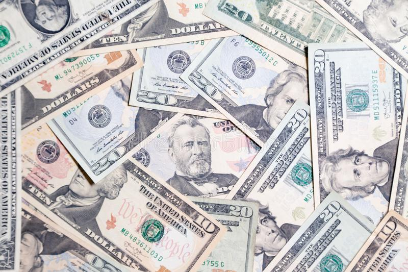 Lote do close up do presidente americano das cédulas do dólar Pulo do conceito, queda, taxa, troca de moeda, débito, lucro, perda imagem de stock royalty free