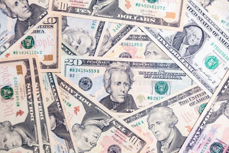 Lote do close up do presidente americano das cédulas do dólar Pulo do conceito, queda, taxa, troca de moeda, débito, lucro, perda foto de stock