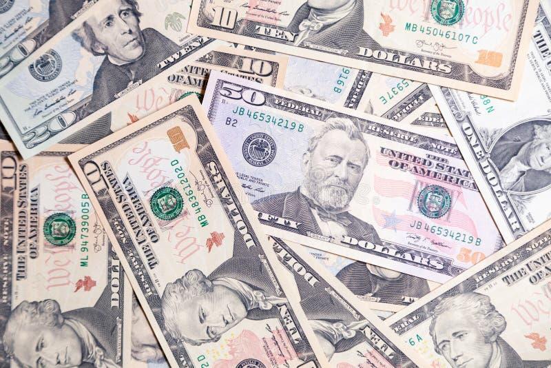 Lote do close up do presidente americano das cédulas do dólar Pulo do conceito, queda, taxa, troca de moeda, débito, lucro, perda imagens de stock