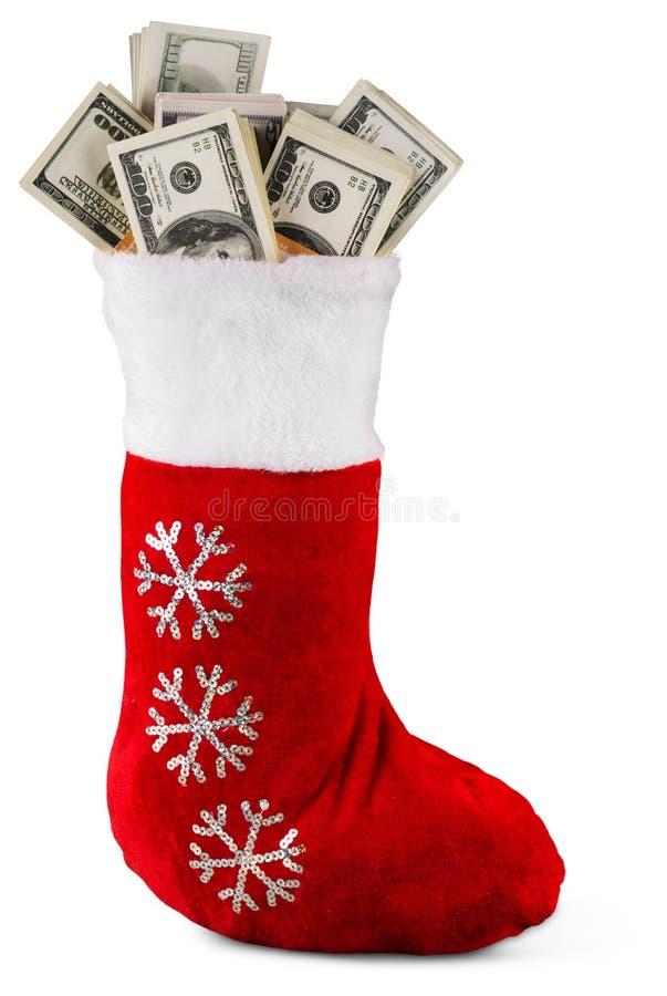 Lote dos dólares em uma peúga do Natal no fundo imagens de stock