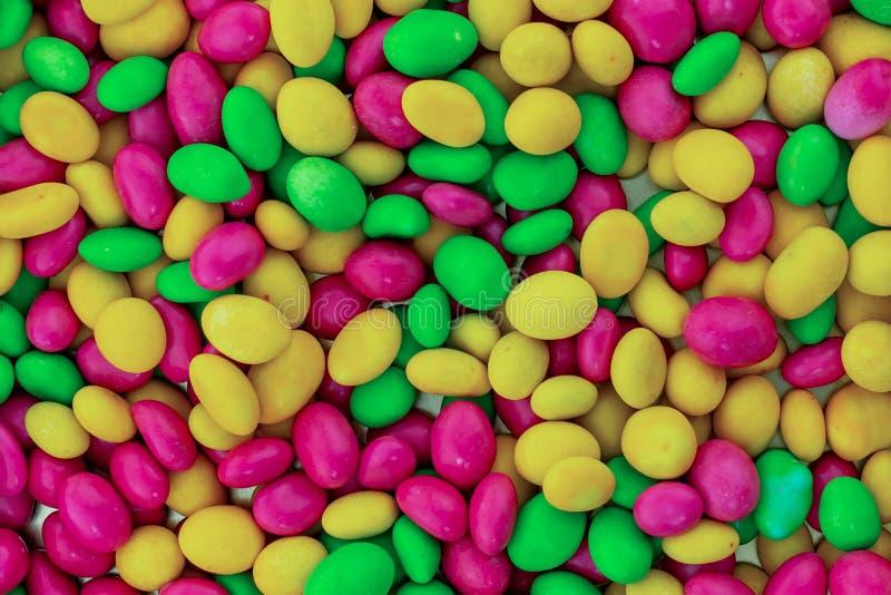 Lote lilás cor-de-rosa verde amarelo oval da textura da base colorida do projeto dos doces festiva fotografia de stock