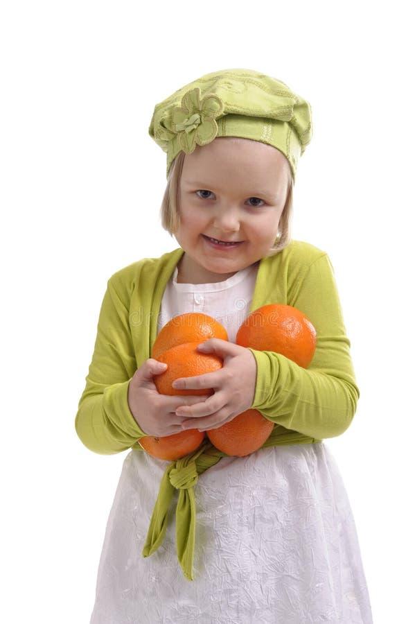 Lotes carreg da menina das laranjas fotografia de stock royalty free