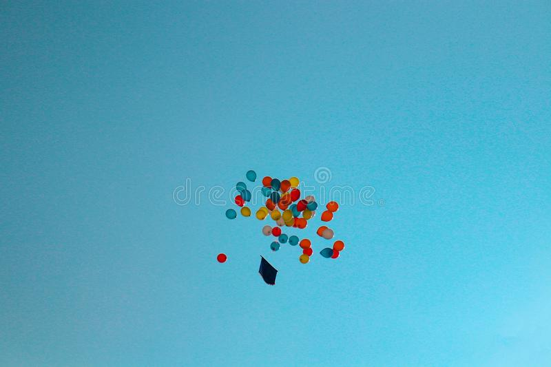 Lots of balloon flying in the sky during a program inaugurating ceremony. stock photo