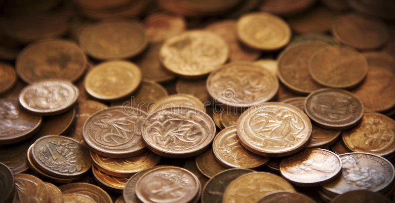 Lots of cents. A pile of old Australian one and two cent pieces stock photos