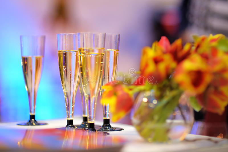 Lots of champagne glasses stock images