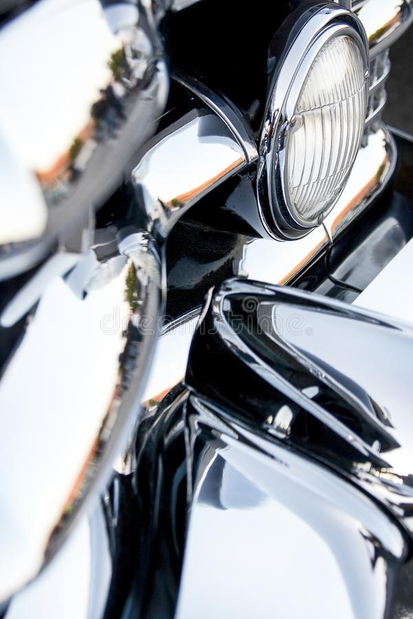 LOTS of Chrome Front End and Headlight Vintage American Car. LOTS of Chrome Front End and Headlight Classic Vintage American Car stock photo