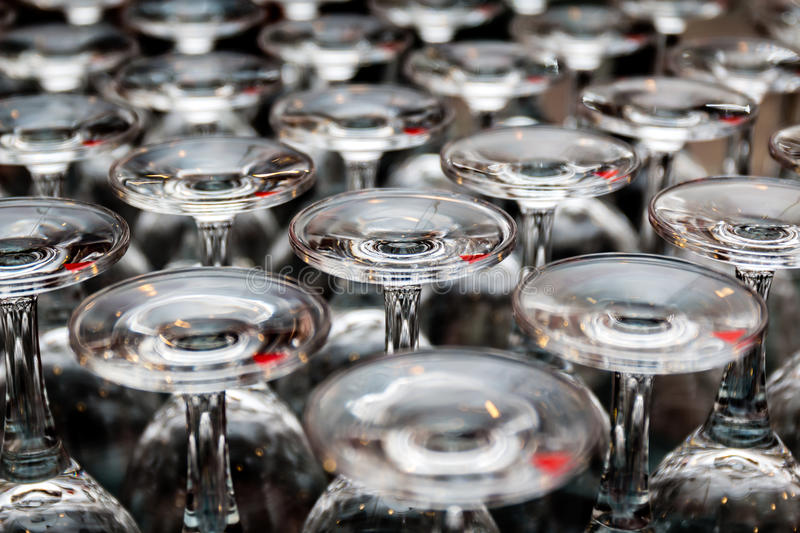 Lots of clear wine glasses. In a conference royalty free stock image