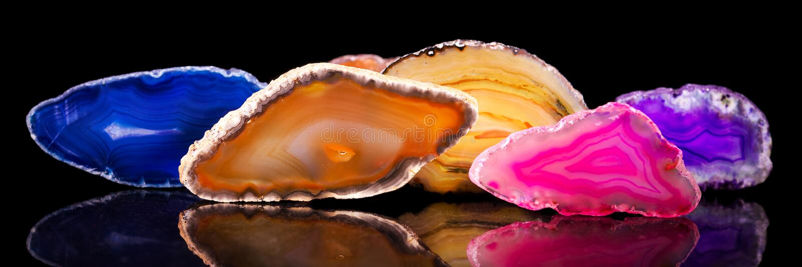 Lots of colorful agate slice, healing stone and mineral, panorama. Banner, header royalty free stock image