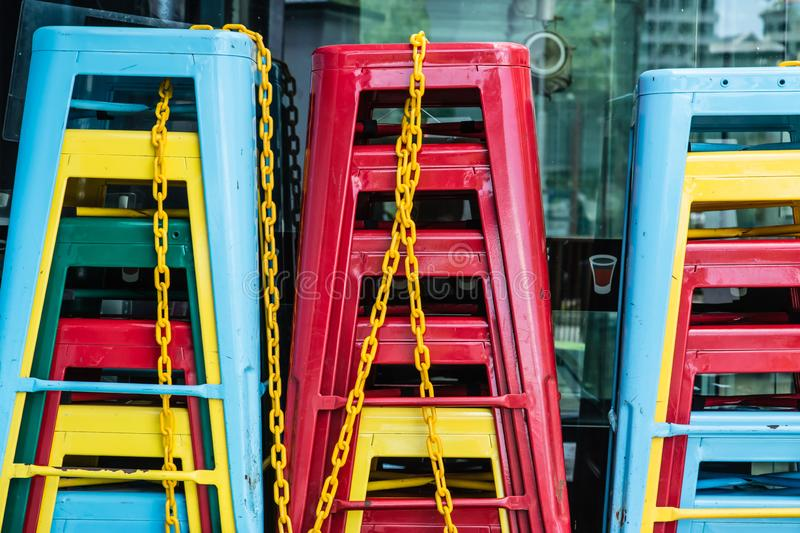 Colorful chairs pile on the road stock images