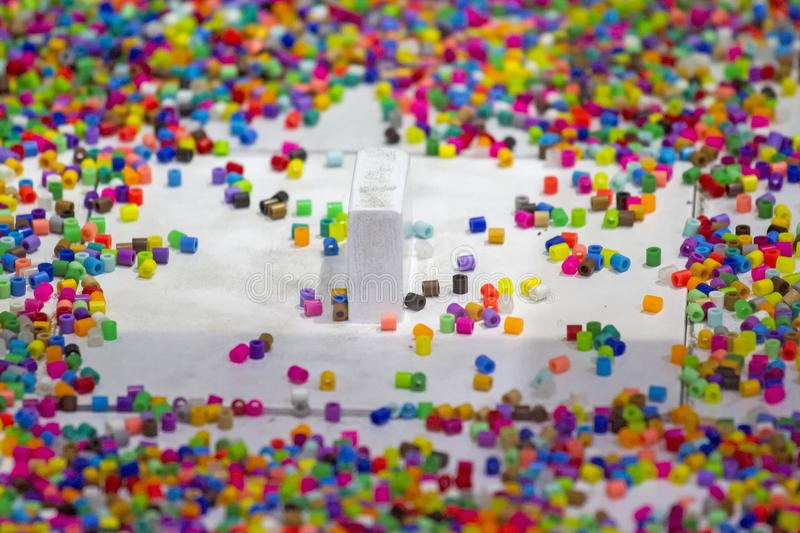 Lots of colorful fusible plastic beads for arts work.  stock photos