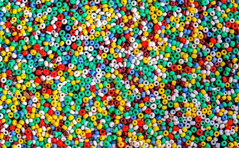 Lots of colorful fusible plastic beads used for arts and craft. Full frame stock photography