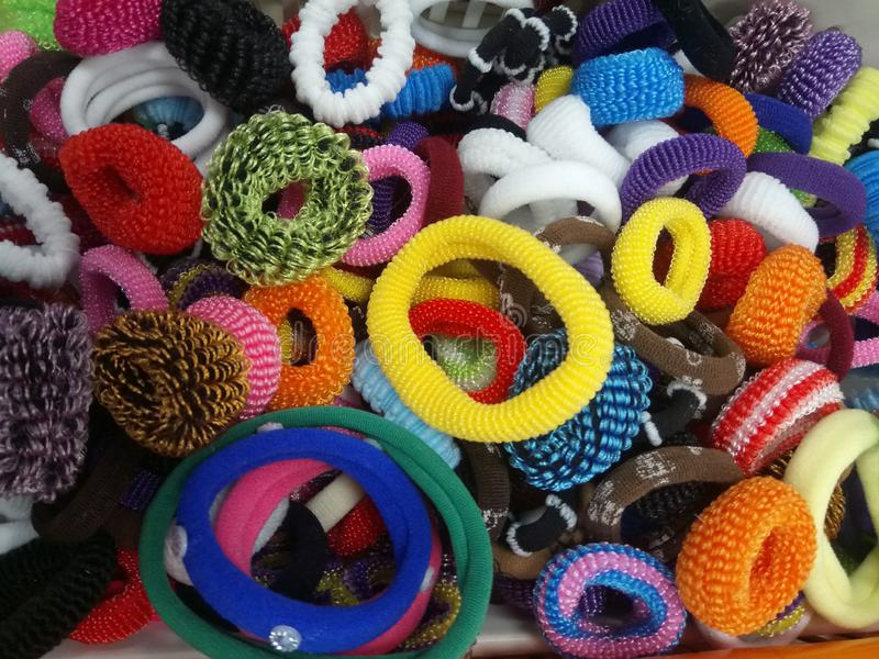 Lots of colorful hair bands royalty free stock photography