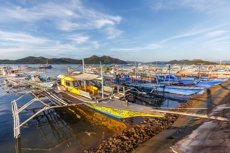 Traditional Philippine bangkas at the harbour of Coron. Lots of colourful Philippine bangkas, mainly outrigger canoes at the harbour of Coron town. From there royalty free stock photography