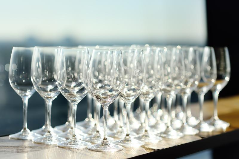 Lots of crystal clear empty wine glasses at the bar. royalty free stock photo