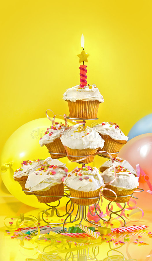 Lots of cupcakes on yellow background royalty free stock photos