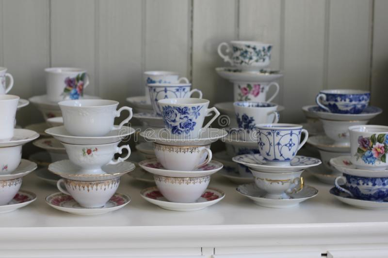 Old coffee cups. Lots of different old coffee cups in piles royalty free stock photos