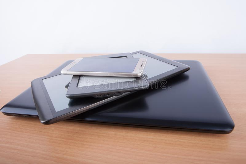 Lots of electronic gadgets on a table - notebook, tablet, ebook royalty free stock photography