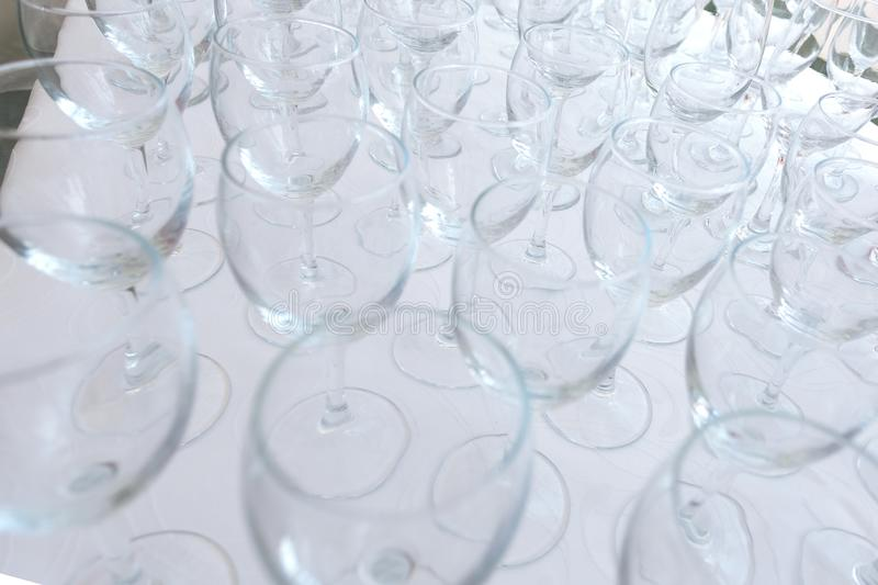Lots of empty glass glasses on the table in the restaurant stock photography