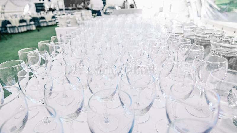 Lots of empty glass glasses on the table in the restaurant stock images