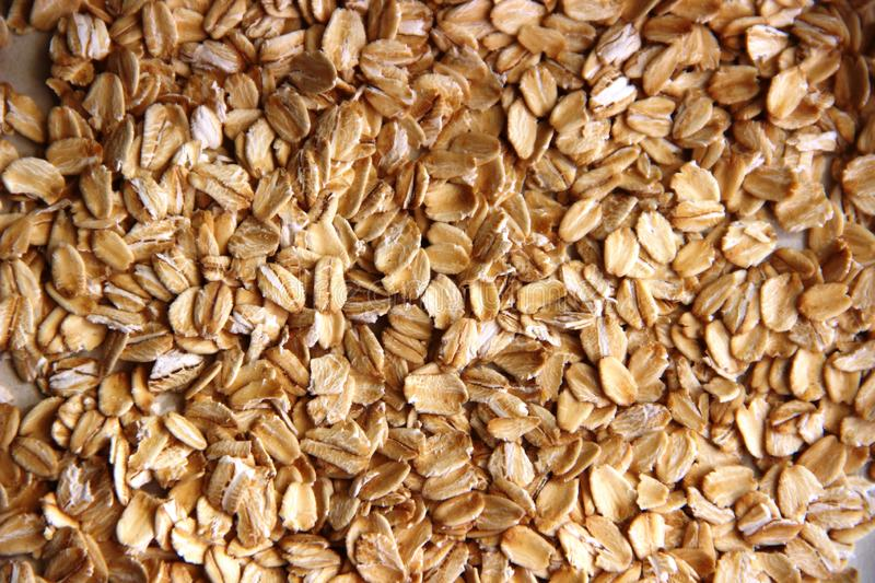 Lots of gluten-free oatmeal. concept of gluten free. oatmeal or oat flakes as background. Lots of gluten-free oatmeal, close-up. concept of gluten free. oatmeal royalty free stock images