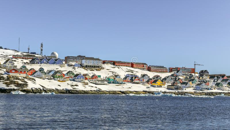 Lots of Inuit huts and colorful houses situated on the rocky coast along the fjord, Nuuk city, Greenland. 8 royalty free stock image
