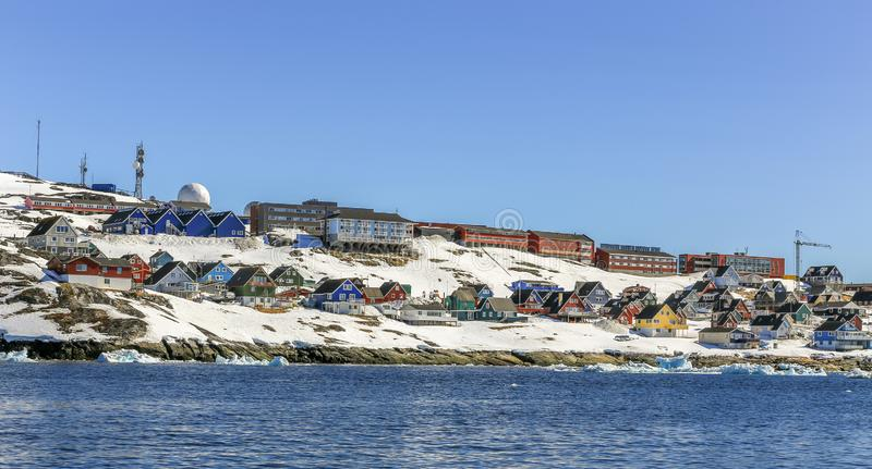 Lots of Inuit huts and living buildings scattered on the rocky coast along the fjord, Nuuk city. Greenland stock images