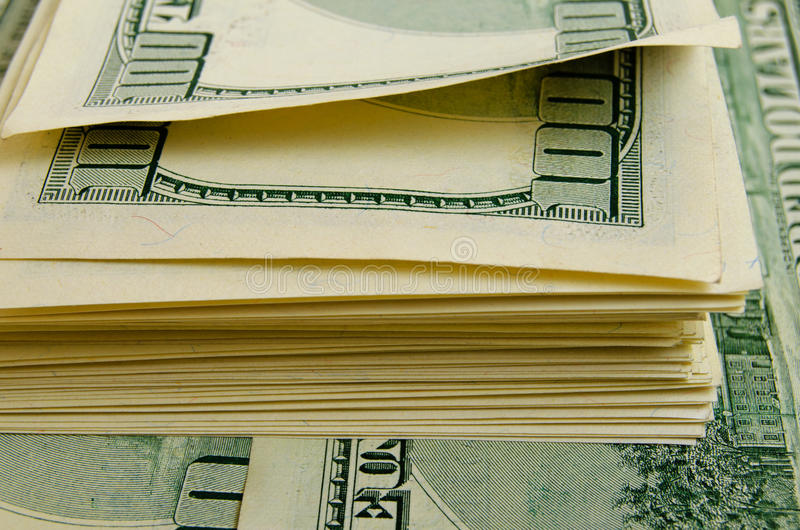 Lots of one hundred of dollar bills. A lot of one hundred of dollar bills royalty free stock images