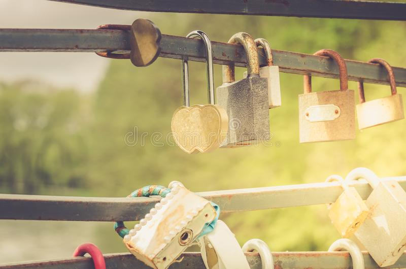 Lots of padlocks, wedding traditions/Close up of row of love locks in sunny day stock photography