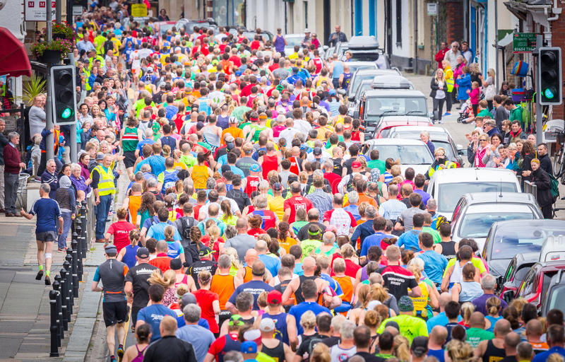 Lots of people running stock photo