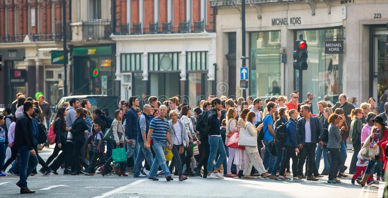 Lots of people, tourists, Londoners shoppers crossing the Regent street. Populated city concept. London, UK stock photos