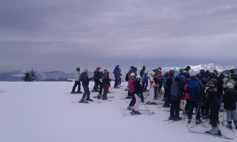 Lots of people waiting for ski lift. stock photography