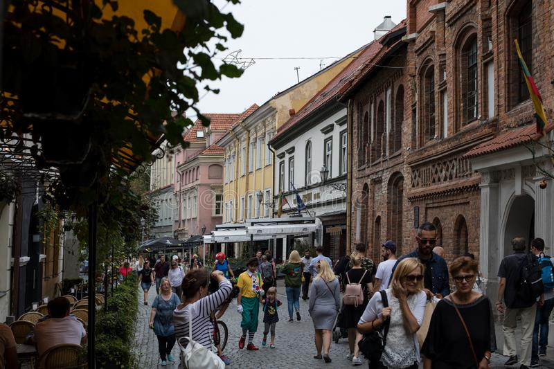 Lots of people walk along Pilies street of Vilnius. Vilnius, Lithuania - September 2, 2018: Lots of people walk along Pilies street, one of the main streets of royalty free stock image
