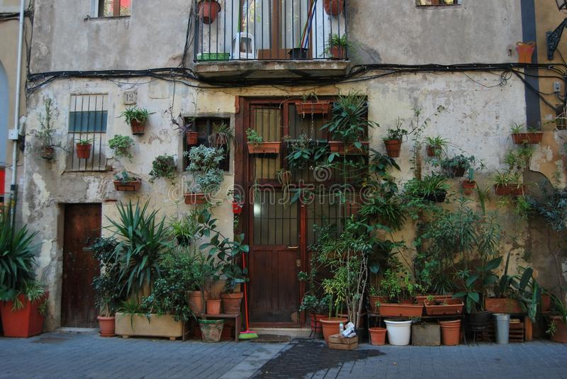 BARCELONA, SPAIN - DECEMBER 2017: Facade of a house in the old city in Barcelona, always full with plants royalty free stock photos