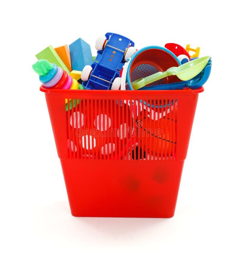 Lots of plastic toys thrown in garbage bin. Lots of modern, colorful plastic toys thrown away in garbage bin royalty free stock photo