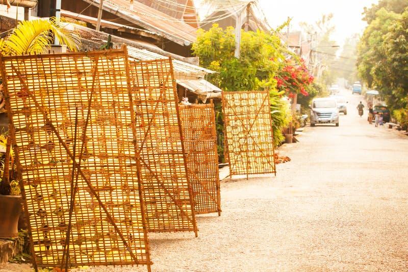 Lots sheet of rice paper on bamboo racks for natural drying on the street of Luang Prabang, Laos royalty free stock photos