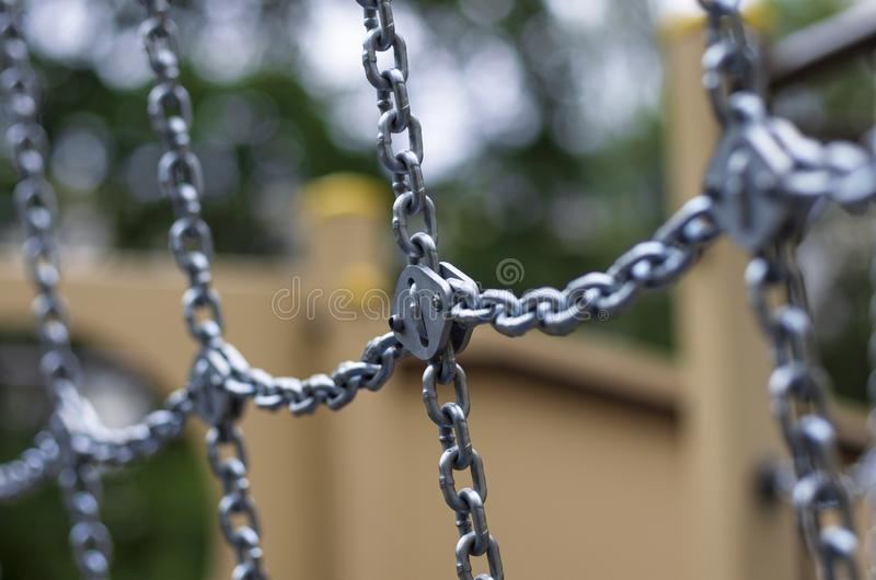 Lots of shiny chain links diagonal and transverse. On the background beautiful bokeh royalty free stock photo