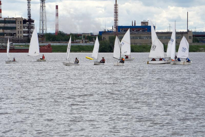 Lots of Small white boats sailing on the lake . royalty free stock image