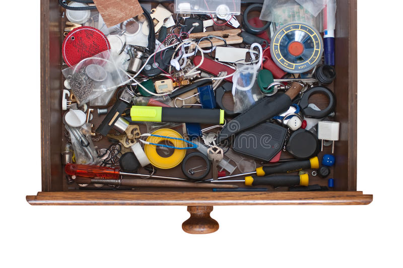 Lots of things in the drawers of his desk stock photos