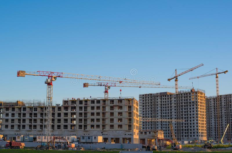 Lots of tower Construction site with cranes and building with blue sky background royalty free stock photo