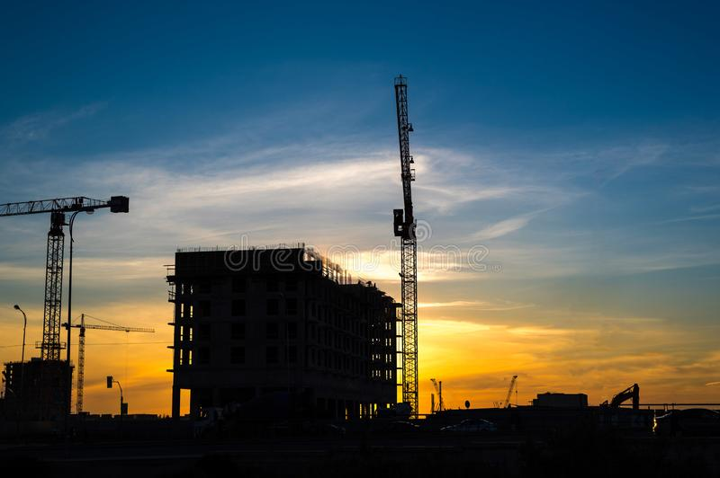Lots of tower Construction site with cranes and building with blue sky background stock image