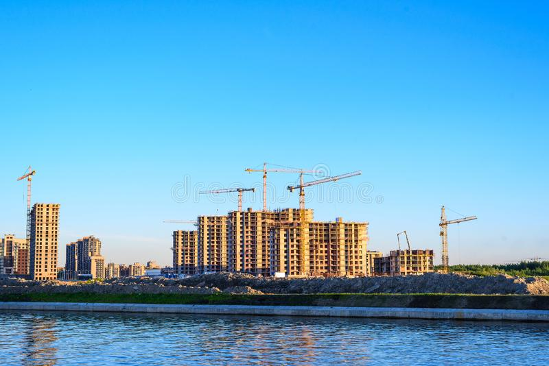Lots of tower Construction site with cranes and building with blue sky background stock photos