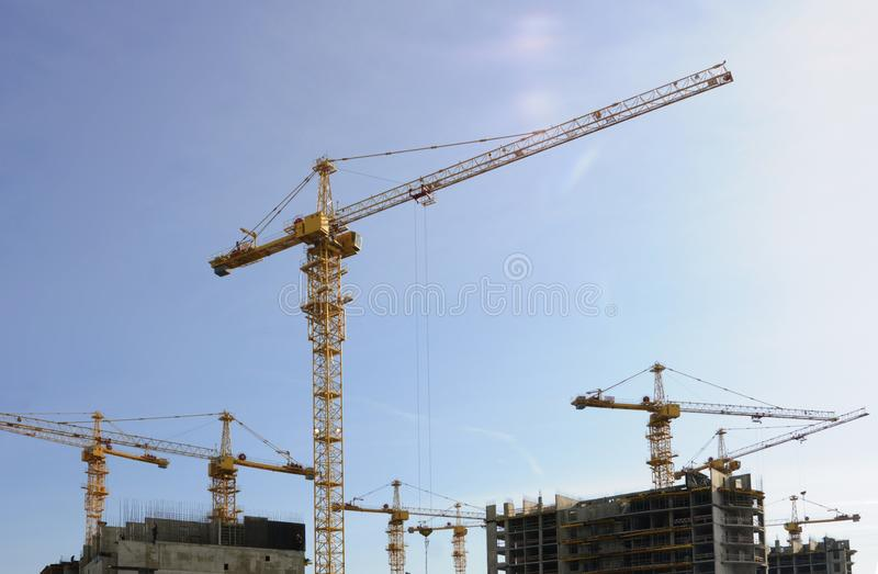 Lots of tower Construction site with cranes and building stock photos
