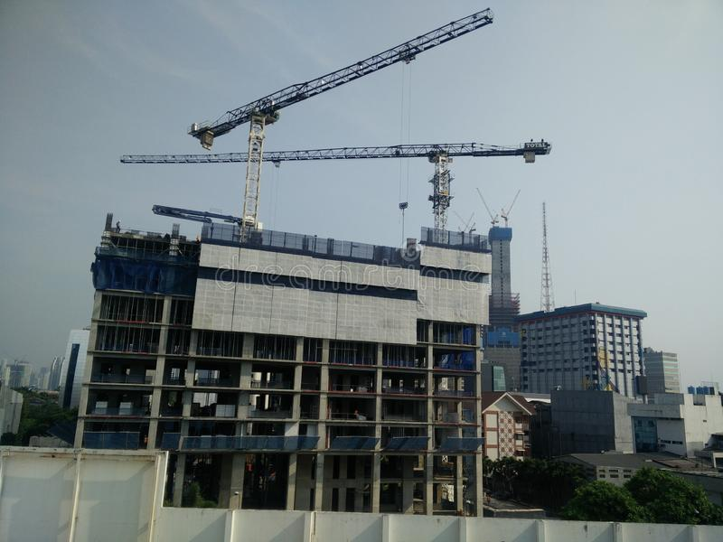 Jakarta/Indonesia July 16 2019 lots of tower construction site with cranes and building with blue sky background stock images