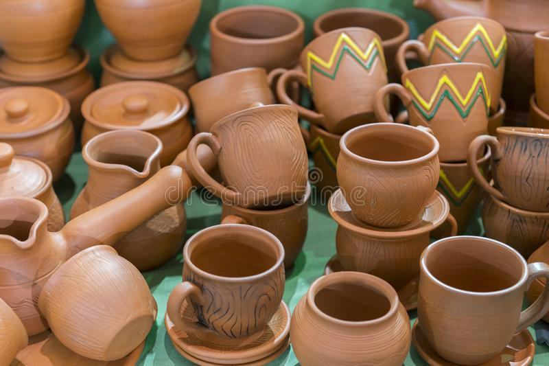 Lots of traditional ukrainian handmade clay pottery production. brown pottery. Clay plates and cups.  royalty free stock images