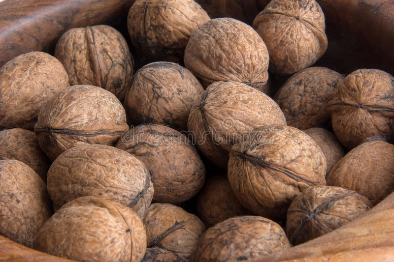 Lots of walnuts. In in wood bowl royalty free stock photo