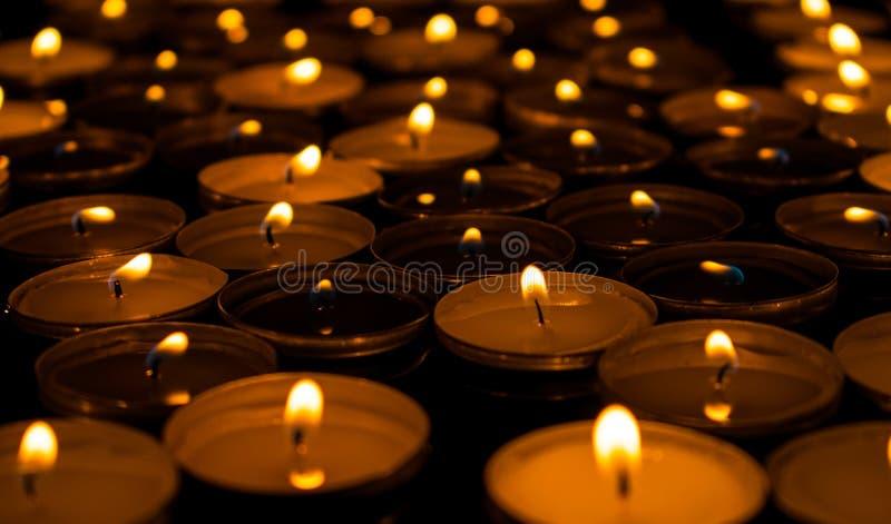 Tea candles burning dark ow angle. Romance. stock photography